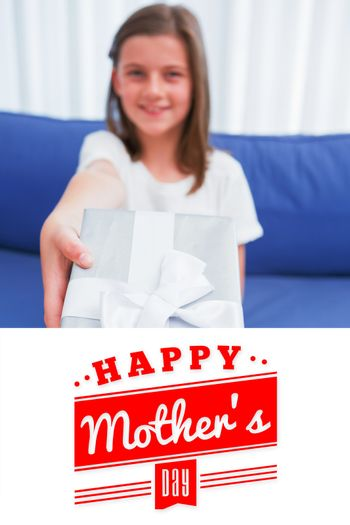 mothers day greeting against little girl offering a silver gift