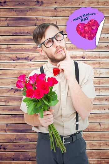 Geeky hipster offering bunch of roses against wooden planks background