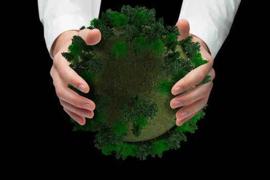 Hands holding against sphere covered with forest