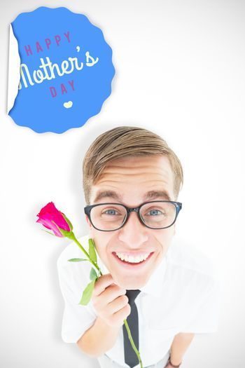 Geeky hipster holding a red rose against mothers day greeting
