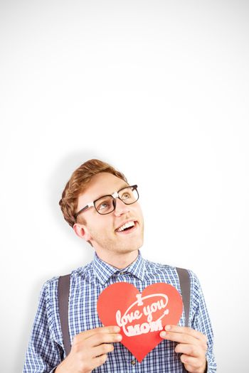 Geeky hipster holding a heart card against mothers day greeting