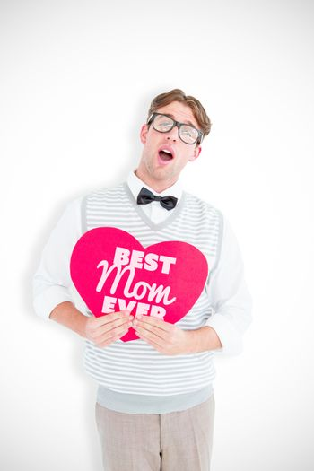Geeky hipster holding heart card against best mom ever
