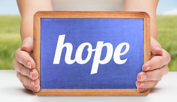 Hope against green meadow
