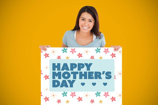 Beautiful woman holding a  board against yellow background with vignette