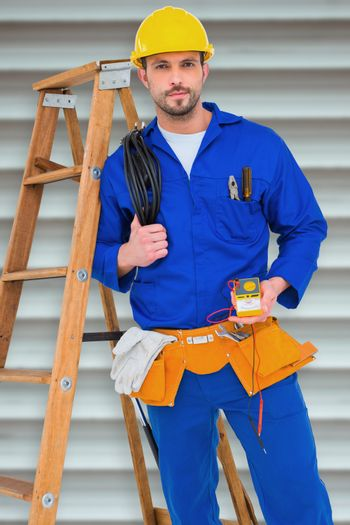 Composite image of electrician holding cables and multimeter