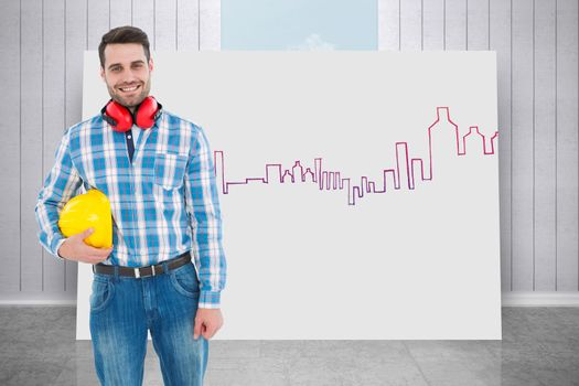 Composite image of confident manual worker with hardhat and ear muffs