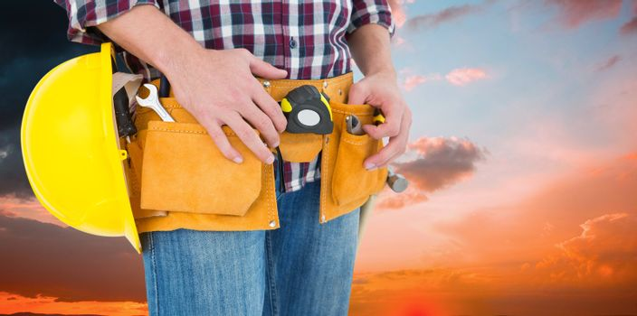 Composite image of handyman with tool belt and handyman