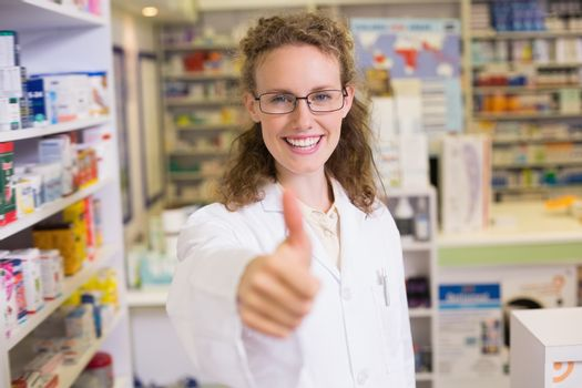 Pharmacist holding her thumb up