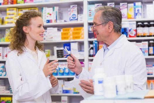 Team of pharmacist talking each other