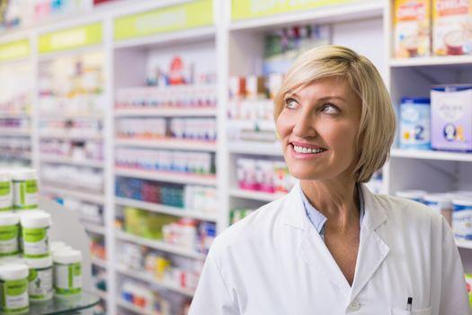 Pharmacist looking up