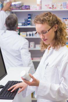 Pharmacist looking at medicine