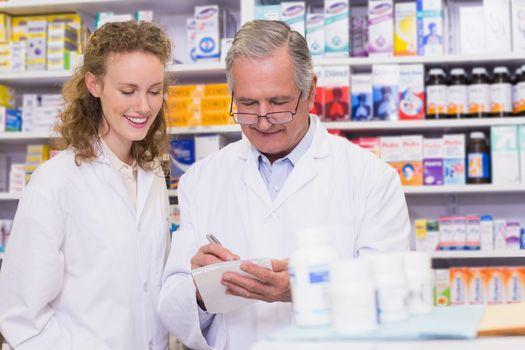 Pharmacists writing a prescription