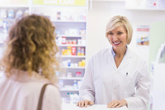 Pharmacist smiling at costumer