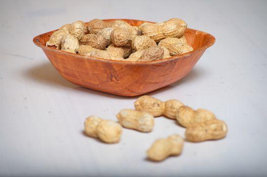 Peanuts in a brown bowl