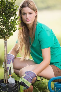 Pretty blonde gardening for her community