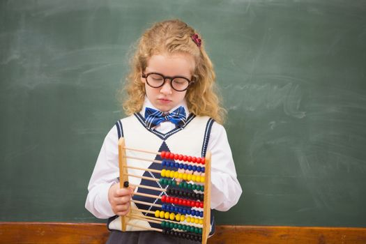 Pupil holding abacus
