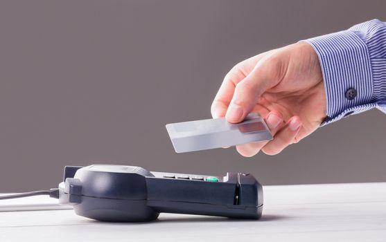 Man using card to express pay