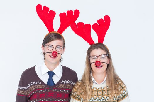 Happy geeky hipster couple with stag headband