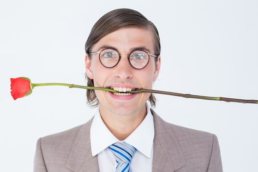 Geeky businessman offering bunch of roses on white background