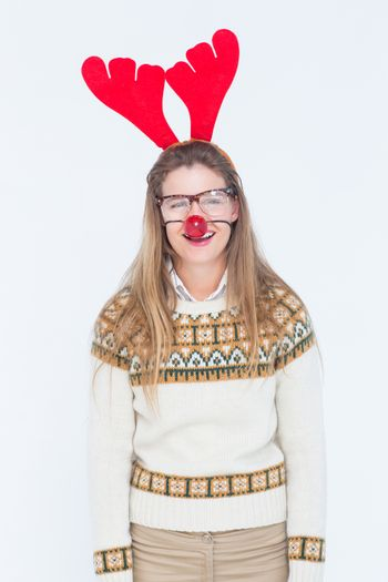 Happy geeky hipster with stag headband