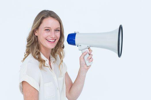 Woman speaking through a loudspeaker