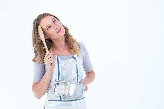 Thoughtful woman holding saucepan