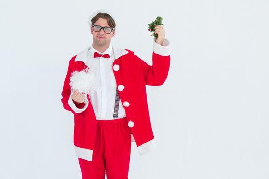 Geeky hipster in santa costume beard and mistletoe