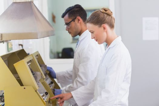 Scientists using technology for research in the laboratory