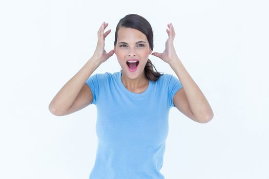 Angry woman raising her hands up