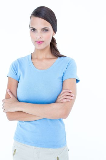Unsmiling woman looking at camera with arms crossed