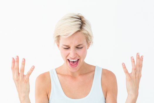 Angry blonde yelling with hands up