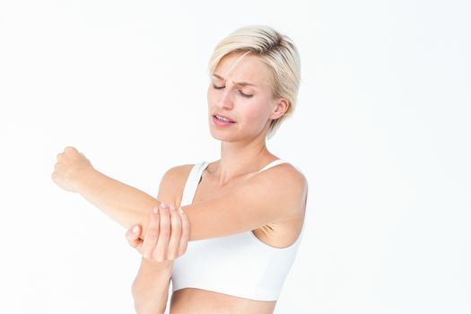 Suffering woman touching her sore elbow