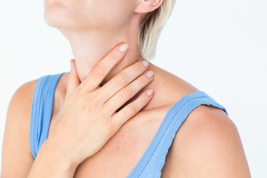 Blonde woman suffering from throat pain