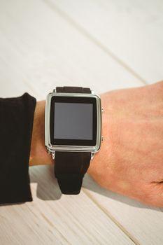 Businesswoman using a smart watch