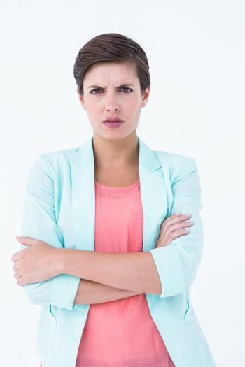 Angry woman with arms crossed looking at camera