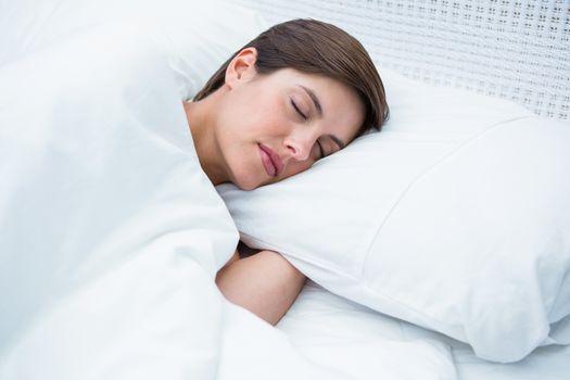 Peaceful brunette sleeping