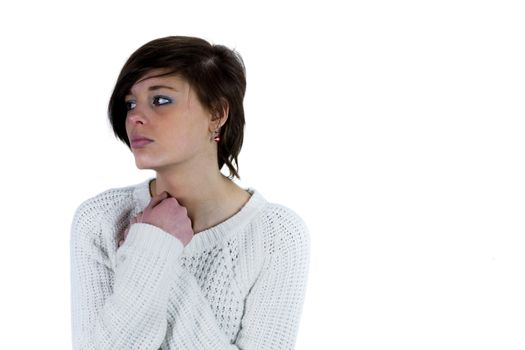 Sad pretty brunette thinking with arms crossed