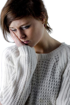 Pretty brunette feeling sad