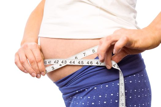 Pregnant woman measuring her bump
