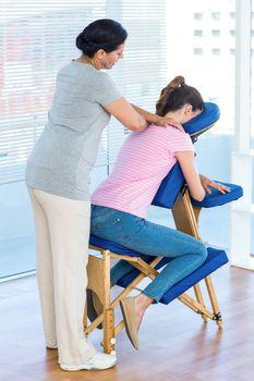 Woman having shoulders massage