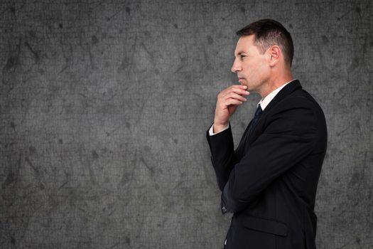 Businessman thinking against grey background