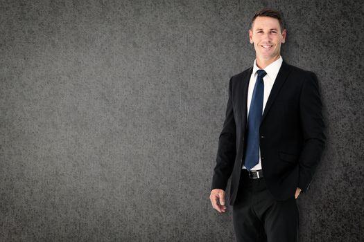Happy businessman against grey background