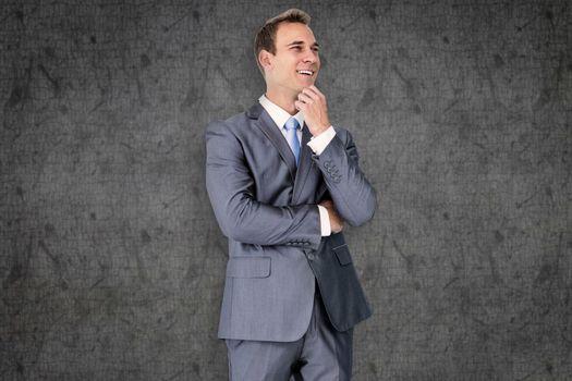 Thinking businessman against grey background