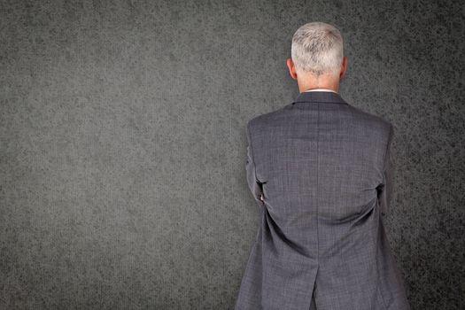 Businessman standing against grey background
