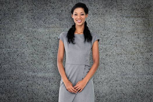 Businesswoman smiling against grey background
