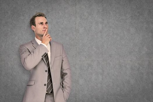 Thinking businessman against grey background