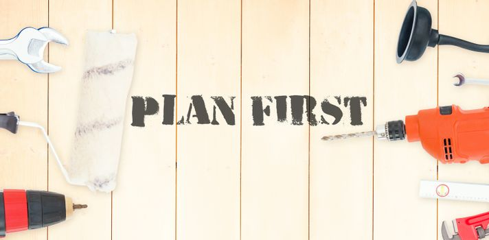 Plan first against diy tools on wooden background