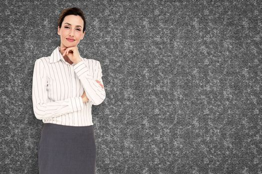 Smiling businesswoman against grey background
