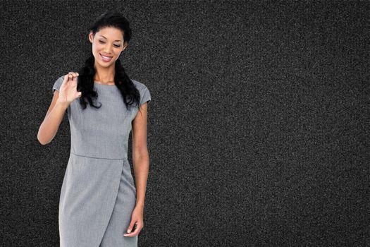 Businesswoman smiling against black background