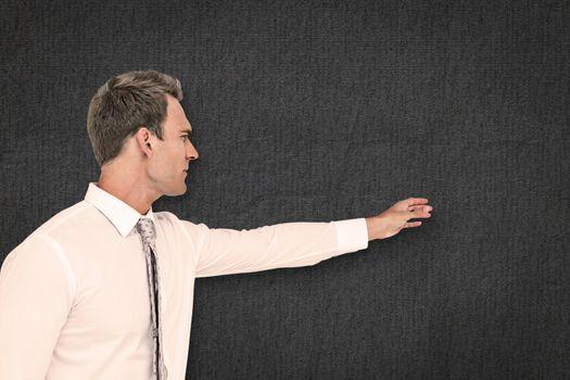 Composite image of businessman reaching